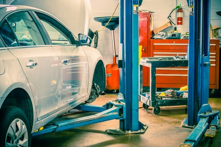 service station: Car Servicing Station with Car Lift. Auto Service Interior. Stock Photo