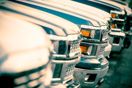 Car Sales. Car Dealer Cars Stock Row Closeup. Brand New Pickup Cars For Sale. Editorial