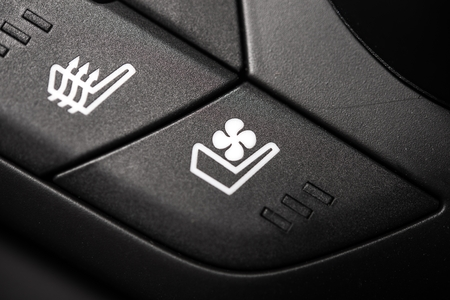 heated: Heated and Ventilated Car Seat Controls. Heat and Ventilation Buttons Closeup