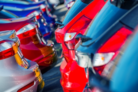 industrial park: Brand New Cars Market. Colorful Car Bodies in Dealer Stock.