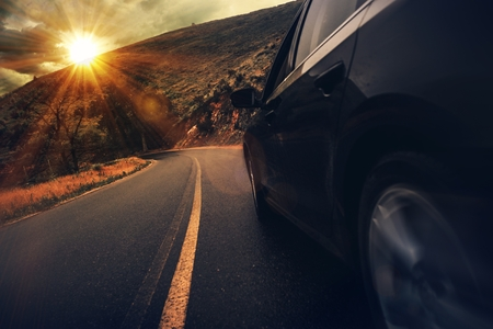 Summer Highway Drive. Mountain Road Driving at Sunset. Stockfoto