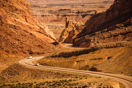 roadway: Rocky Desert Utah Highway with Semi Trucks. Scenic Utah Interstate Highway I-70. United States. Stock Photo