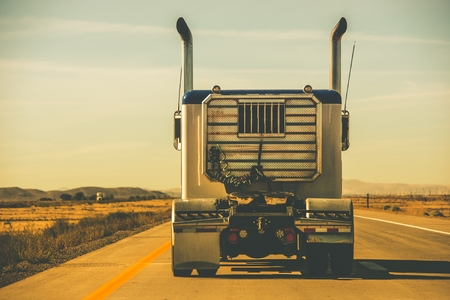 heavy industry: Tractor Trailer on the Highway. Trucking Theme.