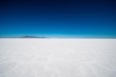 Salt Flats in Utah. Salt Flats Landscape. Dark Blue Sky and Snow White Salt Soil. Boneville near Salt Lake City, Utah, United States. Bonneville Salt Flats