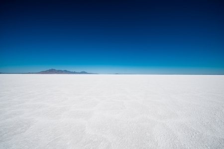 lake: Salt Flats in Utah. Salt Flats Landscape. Dark Blue Sky and Snow White Salt Soil. Boneville near Salt Lake City, Utah, United States. Bonneville Salt Flats
