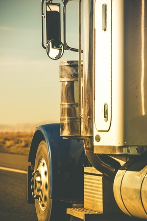Semi Truck Tractor Closeup on the Highway in Vertical Photography. Stock Photo - 32170256