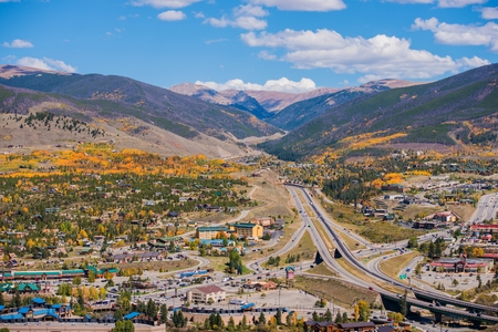 dillon: Silverthorne and Dillon Cities in Colorado. Cities Panorama with I-70 Interstate Highway in the Middle. Early Fall Time.