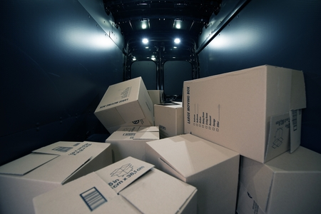 moving van: Cardboard Moving Boxes in the Large Commercial Van Cargo Area.  Stock Photo