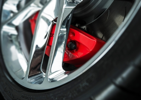 alloy: Red Car Brakes Closeup and Chromed Alloy Wheel. Low Profile Sport Tire