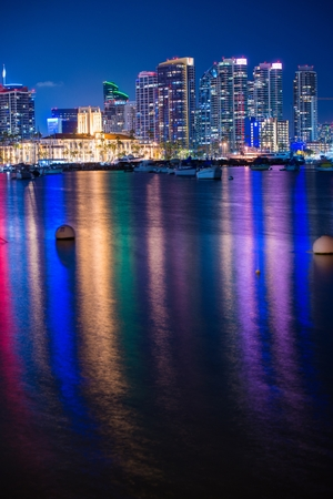 Colorful San Diego Night in Vertical Photography. San Diego Skyline and the Bay with Colorful Water Reflection. San Diego, CA, USA. photo