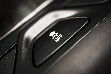 Traction Control Off Button Closeup. Traction Control in Car System. Safety Car Feature.