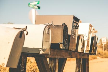 Mailboxes on the American Desert Road Closeup Photo. California, USA. Vintage Desert Color Grading.