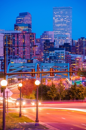 colorado skyline: Busy Denver Streets, Speer Boulevard Platte River Bridge and the City Skyline. October Night in Denver.