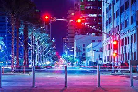 San Diego City Center Intersection at Night. Red Lights Traffic Lights. San Diego, California, USA. Stock Photo