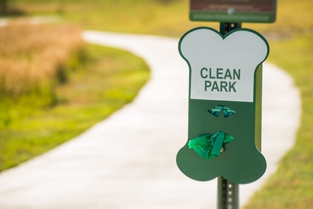dog poop: Poo Free Park Sign. Free Vinyl Bags For Dog Owners.