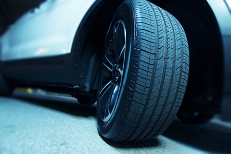 all weather: Brand New Car Tire Closeup Stock Photo