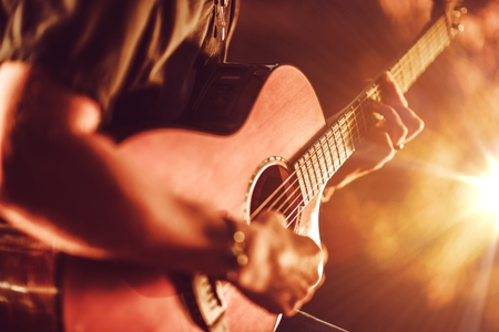 Acoustic Guitar Playing. Men Playing Acoustic Guitar Closeup Photography.