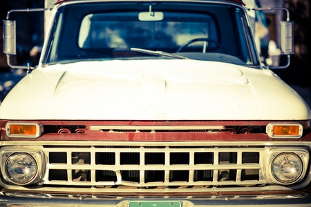 jalopy: Aged Truck Front Closeup. Rusty Abandoned American Pickup Truck.