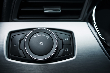 driving conditions: Car Exterior Lighting Control Button Switcher. Modern Car Lighting Controller. Fog Lights Control. Stock Photo