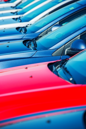 car park: Car Manufacturer Stock. Modern Vehicles Stock. Car Factory Brand New Stock Closeup. Stock Photo
