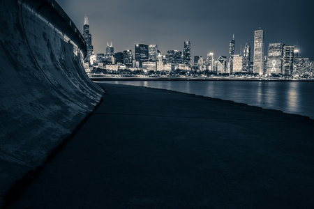 grading: Chicago Skyline at Night and the Lake Michigan Concrete Shore. Urban Dark Blue Color Grading.