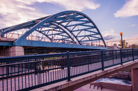 colorado city: Denver Road Bridge. Speer Boulevard Bridge at Sunset. Bridge Traffic. City of Denver, Colorado, United States. Stock Photo