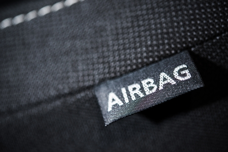 sew tags: Side Car Airbag Tag. Modern Car Safety Feature. Transportation Technologies. Stock Photo