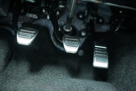 pedals: Car Pedals. Modern Car Clutch, Gas and Brake Pedals Closeup.