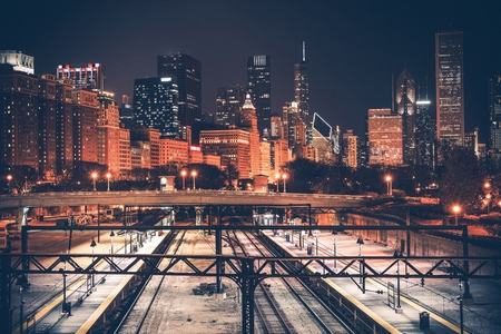 metro: Chicago Skyline and Railroad System at Night. Chicago, Illinois, United States.