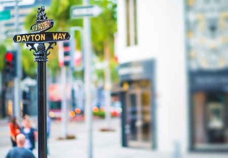 street name sign: Rodeo Drive and Dayton Way Intersection. Famous Beverly Hills Shopping Street. Beverly Hills, United States.