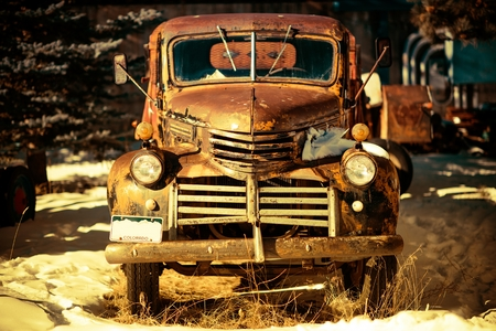 junk car: Rusty Aged Pickup Truck Abandoned in Colorado, United States. Stock Photo