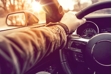 fast car: Hand on Wheel Car Driving.  Driving Modern Car Steering Wheel and the Hand Closeup. Stock Photo