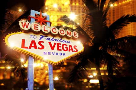las vegas sign: Hot Night in Las Vegas. Vegas Heat Concept Image with Las Vegas Welcome Sign and Strip Lights. Stock Photo