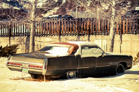 jalopy: Rusty American Classic Car Abandoned Somewhere in Colorado, USA. Junk Car Under Snow.