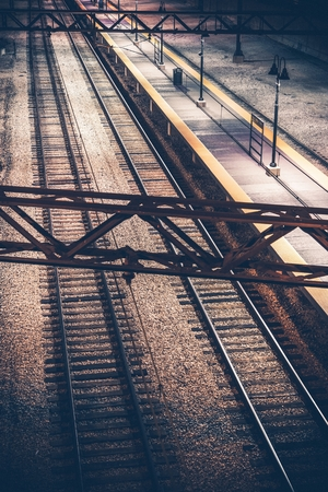 railroad station: The Railroad Station at Night. Vertical Photography. Railroad System. Stock Photo