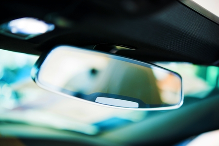 car safety: Vehicle Rear View Mirror. Car Interior Safety Feature Closeup