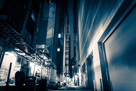 grading: Big City Alley at Night. American Downtown Alley After Dark. Blue Color Grading. Stock Photo