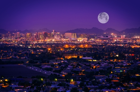 residential home: Phoenix Arizona Skyline at Night. Full Moon Over Phoenix, Arizona, United States. Stock Photo