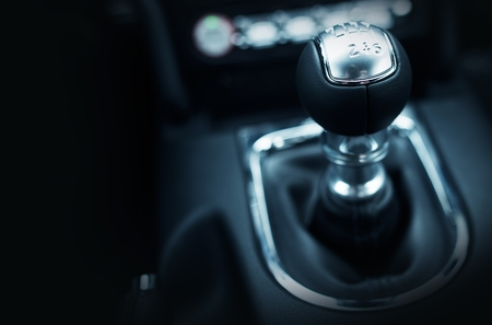 shifting: Six Speed Stick Shift Car Transmission. Stick Shift Driving. Modern Car Interior.