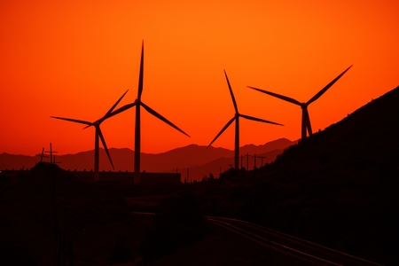 dexter: Wind Energy Concept. Wind Turbines and the Sunset. Stock Photo