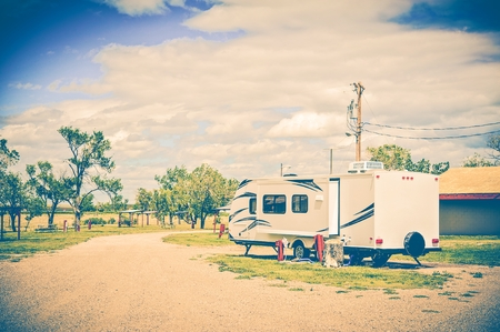 hooked up: Camping in South Dakota. Travel Trailer Hooked Up in RV Park. RV Traveling  Theme. United States.