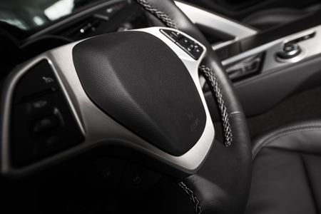 dui: Car Steering Wheel. Driving Concept. Dark Car Interior with Steering Wheel Closeup.