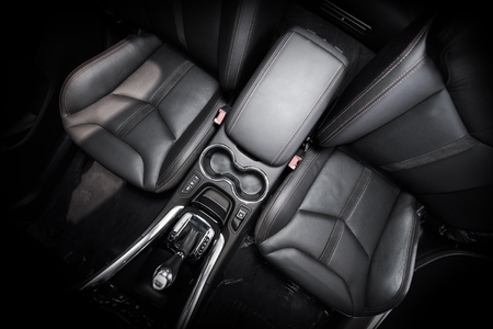 vehicle seat: Modern Car Black Leather Interior. Front Car Seats. Wide Angle Photo From Above.