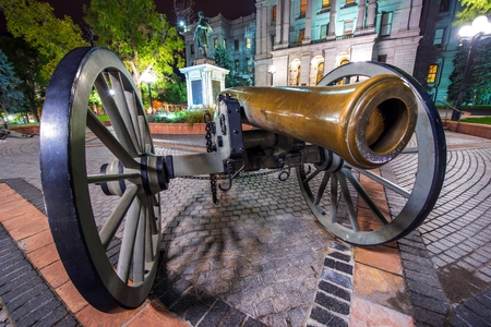 gunnery: Large Cannon in Denver. Cannon in Front of Capitol Building at Night. Colorado, United States.