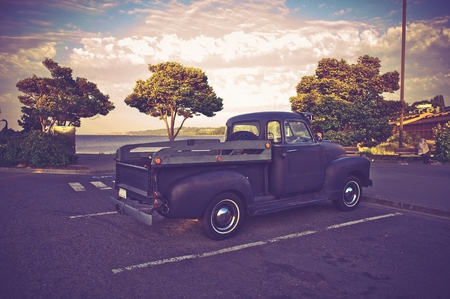 jalopy: Vintage American Pickup Truck in Washington State, USA. Vintage Purple Color Grading. Editorial