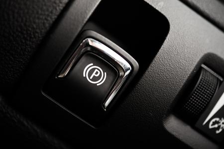 feature: Electronic Brake Button. Modern Car Feature. Brake Button Closeup