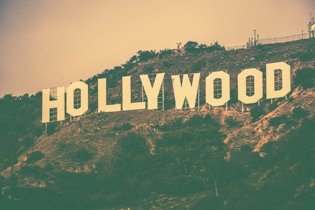 famous industries: Famous Hollywood Hills in Los Angeles Metro Area, California, United States. Hollywood Sign in Vintage Color Grading. Editorial