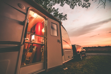 rv: Travel Trailer Camping. RV Trip Theme. Evening in RV . Vintage Color Grading.