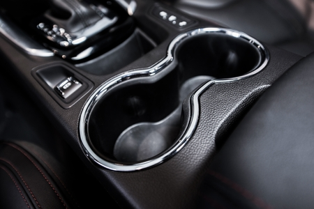 car front: Vehicle Cup Holders in Between Front Car Seats. Cup Holder Closeup. Stock Photo