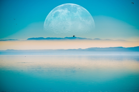 beyond: Beyond the Horizon. Fantasy Landscape with Large Moon on the Horizontal, Mountains and the Calm Sea.